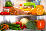 Open fridge. Healthy food. Vegetables and fruits