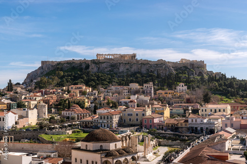 Keuken foto achterwand Athene View of Acropolis rock and Monastiraki square at Athens on blue sky background.