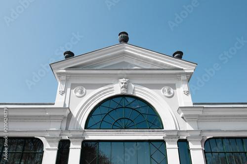 Building facade with blue sky. Copy space. Space for text. Pálma rendezvényház, Tata, Hungary - 200424879