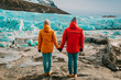 Traveling Man And Woman Exploring The Iceland Together. Ice Lagoon. Iceland traveling.