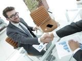 handshake business partners at your Desk - 200426214