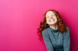 Leinwanddruck Bild - Young laughing woman against pink background