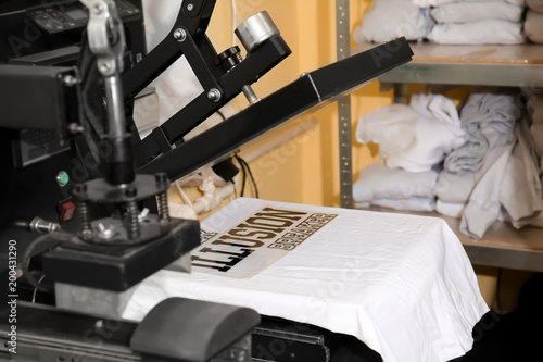 Modern printing machine with t-shirt at workplace © Africa Studio