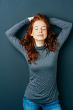 Serene attractive young redhead woman - 200431449