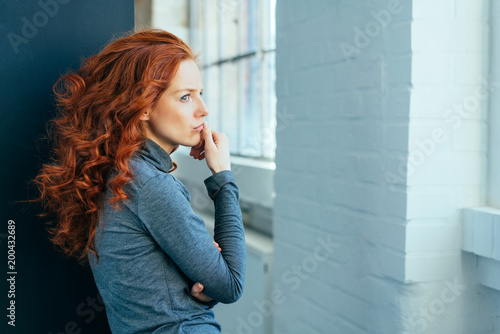 Sad lonely thoughtful young woman