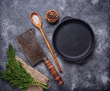 Culinary background with spices, pan and cleaver   - 200441453