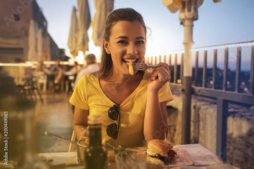 Girl eating outdoors - 200449865