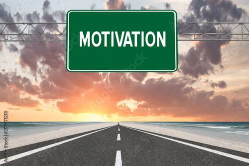 Motivation text on highway sign at beach