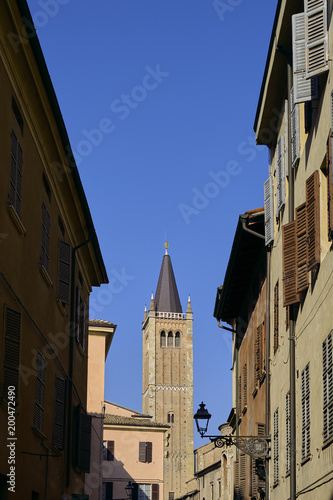 Foto Murales Narrow colourful alley on a sunny Winter day, Parma, Italy