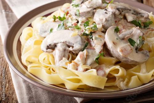 Traditional Italian fettuccine with Boscaiola sauce, mushrooms, bacon close-up on a plate. horizontal - 200485087