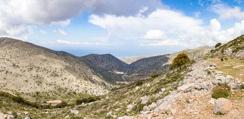 Panorama - Mountains in the eastern part of the island Crete, under heavy clouds cover. Lassithi region, Greece.