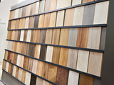 Samples of wooden laminate panels in store - 200518699