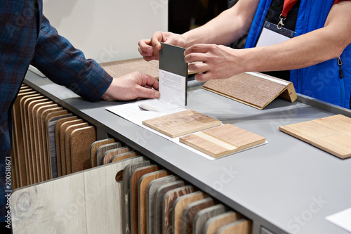 Buyer and seller in hardware store - 200518671