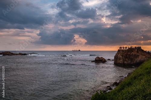 Fotobehang Zee zonsondergang Sunset in Sri Lanka. People enjoying the landscape. Conceptual image of happiness, calmness and beauty.