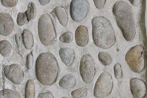 Aluminium Stenen Rock wall of natural river stones. Round stones wall background. River round Stones pattern. Stones texture. River rocks background.