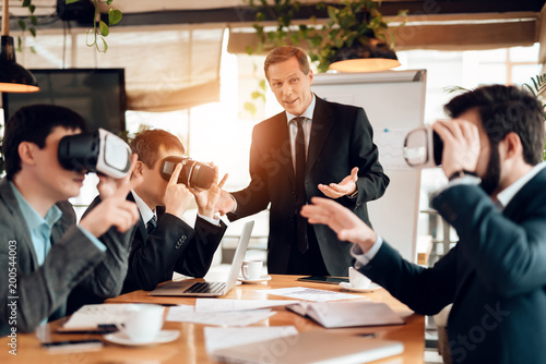 Meeting with chinese businessmen in office. Men are using virtual reality.
