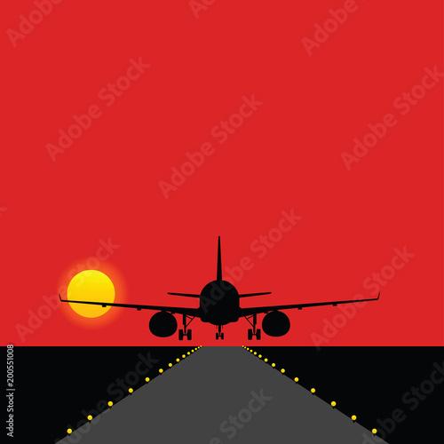 Fototapeta airplane landing on the runway with bulbs