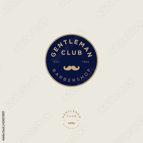 Gentleman club. Barbershop logo. Golden letters and mustaches in a dark blue circle. Male salon logo. Premium icon or sign.