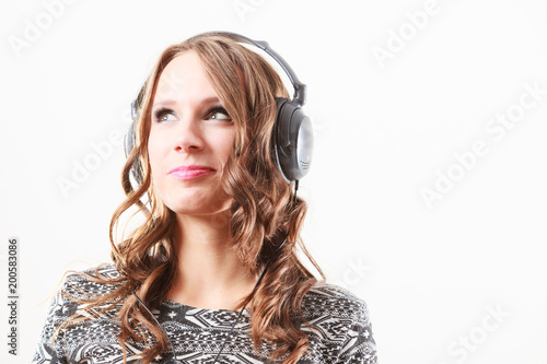 woman in headphones listening music mp3 relaxing - 200583086