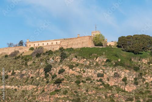 Fotobehang Barcelona Montjuic fortress overlooking Barcelona harbor from the port