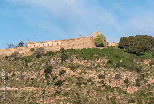 Montjuic fortress overlooking Barcelona harbor from the port Poster