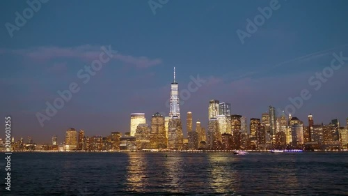 Sticker View of the New York Skyline as the lights reflect in the water.
