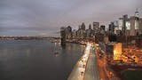 Wide view of traffic on FDR Drive in New York at dusk. - 200604810