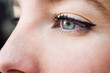 Close-up shot of blue eye of young woman