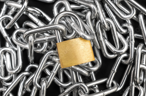 Golden padlock on the heap of chain Poster