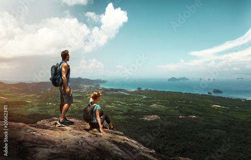 Hikers relax on the top of maountain,man and woman enjoy great nature landscape