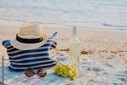 Picnic background with bag, grape and white wine by blue sea - 200636860