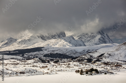 Foto op Plexiglas Ochtendgloren Beautiful landscape with clouds and mountains in background at Lofoten Island, Norway