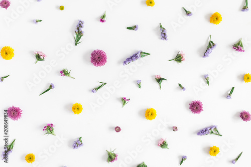 Foto Murales Flowers composition. Pattern made of colorful flowers on pastel blue background. Flat lay, top view