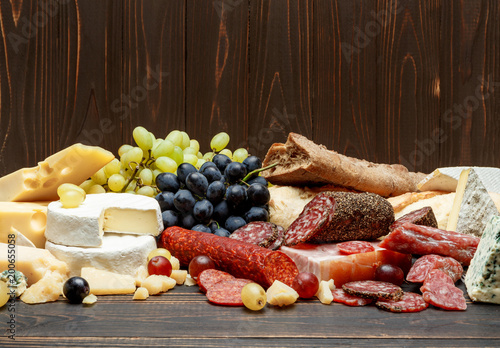Traditional italian products with salami, cheese, bread and fruits
