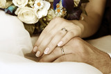 Hand of the groom and the bride with wedding rings - 200663402