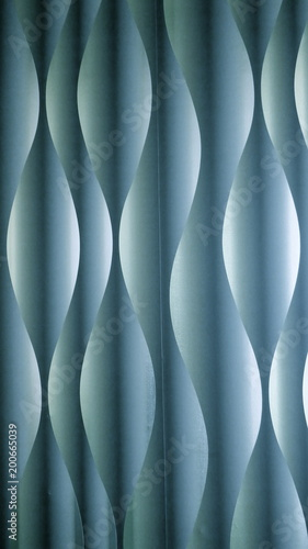 Hintergrund und Textur, türkis, blau, grün. Abstraktes Wellen- oder Spiralmuster mit Licht- und Schatteneffekt.