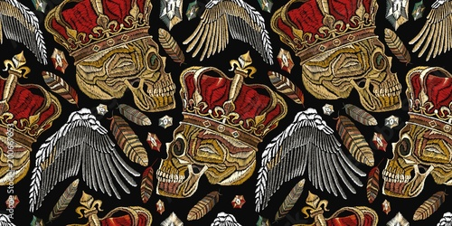 Embroidery medieaval seamless pattern. Fashion template for clothes, textiles, t-shirt design. Embroidery golden crown, human skull, feathers and angel wings seamless pattern