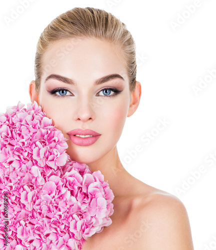 Young beautiful woman with flowers near face. - 200680296