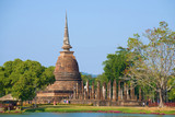 View of the ruins of the ancient Buddhist temple of Wat Sa Si on a sunny day. Sukhothai Historical Park, Thailand - 200680489
