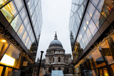 St.Paul's Cathedral reflected on glass office building in London