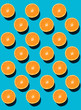 From top view. Colorful fruit pattern of fresh orange slices on blue background.  Above.  - 200689612