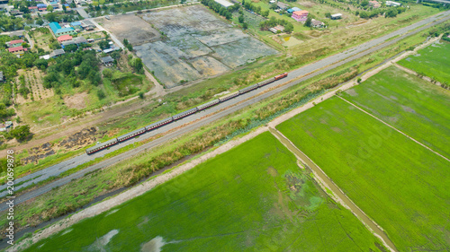 Aerial  view from flying drone of  Field rice  with landscape green pattern nature background / top view field rice