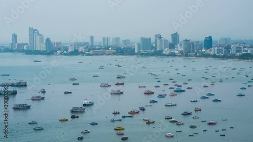 timelapse of Pattaya city and the many boats docking