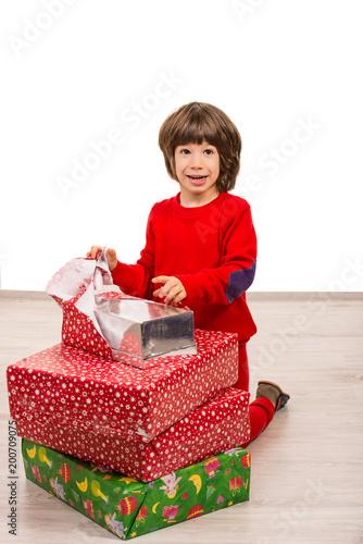 Amazed boy opening Christmas gift
