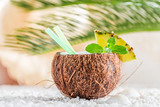 Fresh pinacolada in coconut on white pebbles - 200738649