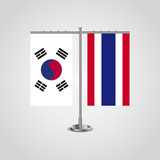 Table stand with flags of South Korea and Thailand.Two flag. Flag pole. Symbolizing the cooperation between the two countries. Table flags