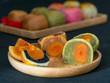 Closeup chinese cake in wooden plate on dark background