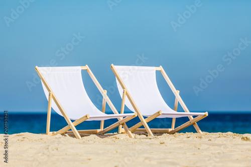 Deck chairs on beach - 200753251