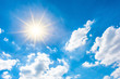 Sunny background, blue sky with white clouds and sun