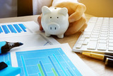 Wealth and savings concept. Man in office holding piggy bank. - 200760007